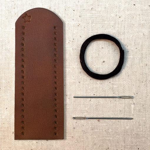 Saddle tan leather lever wrap with baseball stitch