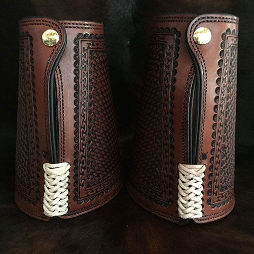 Authentic leather cowboy roping cuffs with custom brand