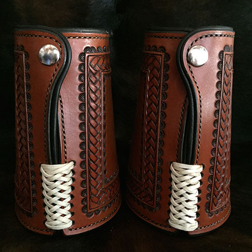 Authentic leather cowboy roping cuffs with braid